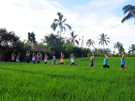 Lunging along rice paddy paths is hard enough…. lifting a coconut above your head looks innocent but adds work!